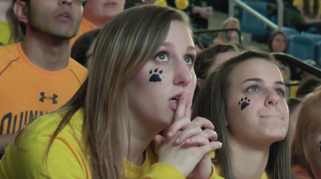 Students react after Quinnipiac falls to North Dakota 5-1 in the National title game