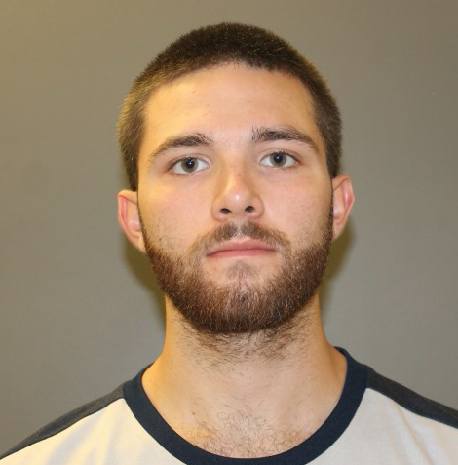 Student arrested after threatening roommate with knife