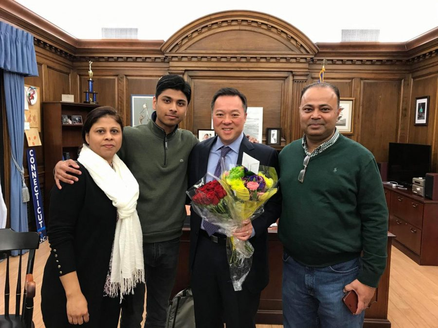 The Mahmud family with Connecticut Attorney General, William Tong