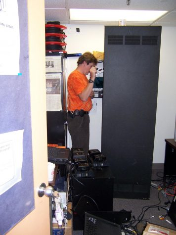 2006- Installing new equipment in the Q30 office in student center